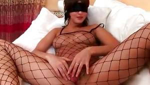 Sluttish chick is wearing the facial mask on eyes all along fingering her unclothes twat