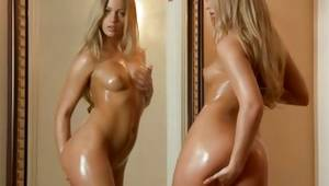 Blonde oily arousing harlot is fingering a pussy gap